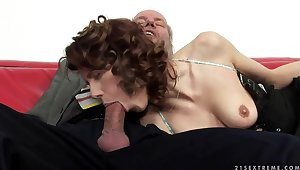 A cute redhead fingers an superannuated man's ass hole