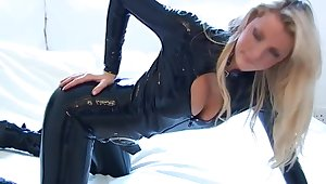 Bending over playful latex whore draws your attention by flashing her ass